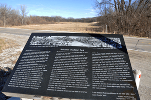 A sign near the Voss property tells the story of the land over the past century.
