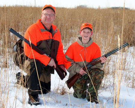 Parent/child hunting teams like Russ Tenold and son Gage Tenold from rural Northwood now hunt a 139-acre �youth hunting� wildlife area in Winnebago County. The first �youth hunting� wildlife area in northern Iowa is reserved for children under 16 and licensed adults 21-years-old and over and is administered by the Winnebago County Conservation Board. The former farm ground has a permanent NRCS Wetlands Reserve Program easement on it and is owned by sisters Martha Olson, Jewell and Diane Rickerl, Aurora, S.D.