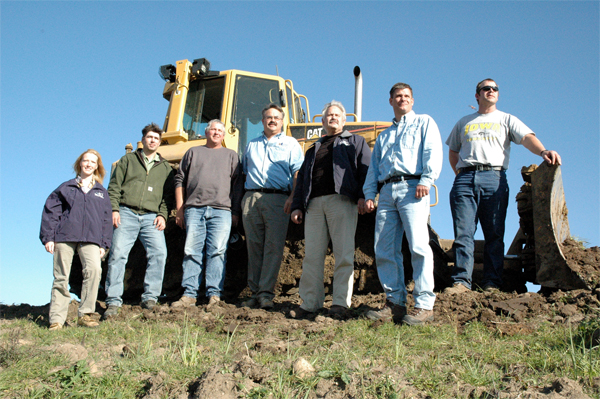 Pictured are Laura Wilden, Bremer County NRCS District Conservationist; Doug Chafa, Iowa DNR Biologist at the Sweets Marsh Wildlife Unit; John Shimek, Iowa DOT Construction Technician; John Moyna, President, CJ Moyna and Sons Inc.; Al Ehley, NRCS Assistant State Conservationist for Field Operations; Mike Webster, NRCS Wetland Specialist; and Charlie Scherf, C. J.  Moyna & Sons Finish Dozer Operator.