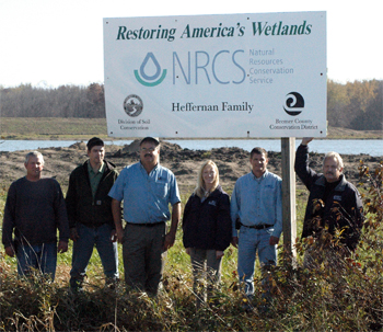 Pictured with Moyna are John Shimek, Iowa DOT Construction Technician, Doug Chafa, Iowa DNR Biologist at the Sweets Marsh Wildlife Unit, Moyna, Laura Wilden, Bremer County NRCS District Conservationist, Mike Webster, NRCS Wetland Specialist and Al Ehley, NRCS Assistant State Conservationist for Field Operations.