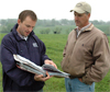 Soil Conservationist Ryan Gerlich, left, worked with cattleman Mike Sweeney on his multi-paddock rotational grazing system.