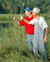 Drew DeLang and Ivan Keller take a look at wild rice.