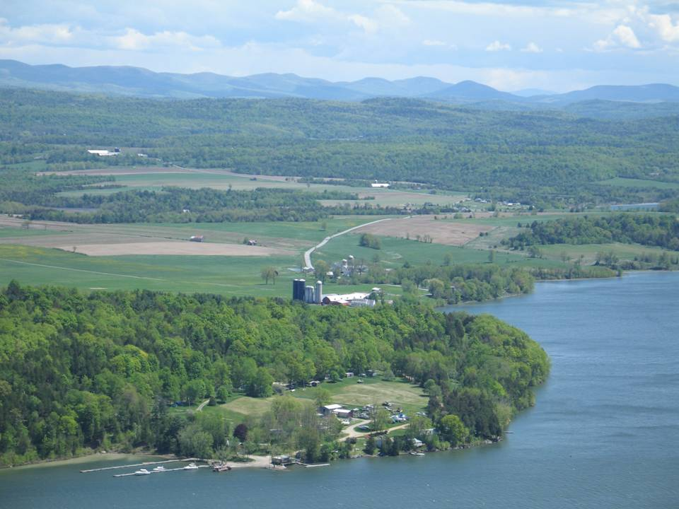Farming and forest land along Lake Champlain.