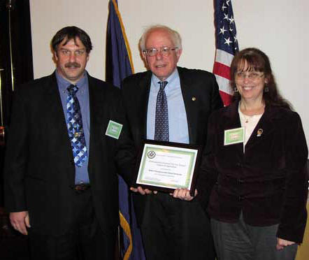 Bob Thompson of NRCS and Cheryl Ducharme of RD pose with Senator Bernie Sanders for a picture after the two won an award for their work with methane digesters