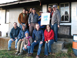Claflin family poses for a picture in front of farm that has been resently conserved through a conservation easement.