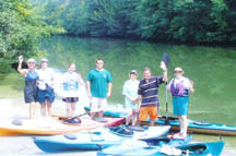Volunteers gather with their canoes before beginning the clean-up.