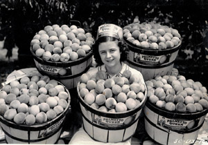 1938: Miss Rachael Tinsley with some of the peaches grown on the John Tinsley farm in Spartanburg, SC.
