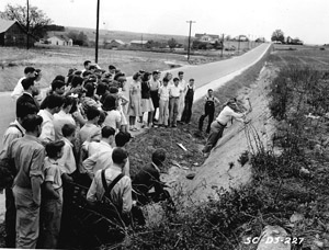 Spartanburg, 1941: Boiling Springs High school students in science and geography study soil structure and horizons. W. E. Fleming is the SCS technician leading the discussion.