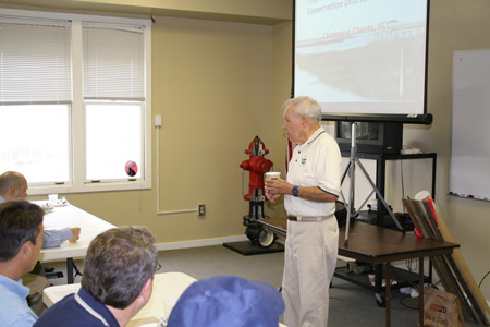 South Carolina Earth Team Volunteer Bill Wilkes talks to the group about dune restoration.
