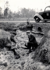May 1936, Duncan, SC: Dr. T.S. Buie and Ernest Carnes inspect a terraced field.