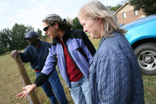Small Farmer Ben Johnson consults with NRCS District Conservationist Diane Leone and Beaufort SWCD Manager Shelby Berry.