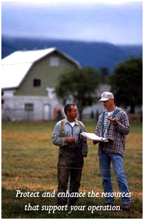 An NRCS emplyee and farmer on a farm