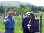 Peyton confers with Richard Lahman and Mike Phillips near one of his new paddocks.