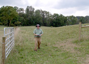 After: Soil Conservationist Philip Davis checks fencing on the paddock system.