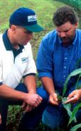 Photo of NRCS conservationist Dan Cotter assisting a person.