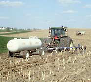 Photo of farmer applying nitrogen.