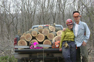 Johnny and his wife Elizabeth (who is also a firefighter) display dueling chainsaws and a load of firewood