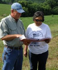 NRCS conservationist reviewing a conservation plan with a producer