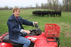 Helen Goebel on 4-wheeler monitoring her livestock operation.