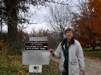 Photo of Helen Goebel standing by the mailbox at Hilltop Farms