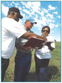 NRCS Planner discussing conservation plan with land owners