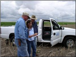 NRCS District Conservationist discussing a conservation plan with a landowner.