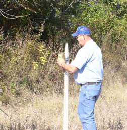 Ron Davis surveying for a wetland restoration project.