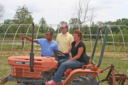 Burthel Thomas, Todd Sewell and Sandra Martin discuss her organic farm and hoop house she is installing through EQIP.