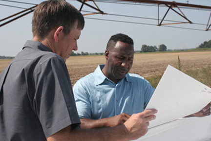 Robert Hankins, Lincoln County district conservationist, discusses a conservation plan with Abraham Carpenter Jr.
