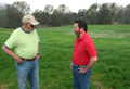 Richard Young (right), a soil conservationist at the Jonesboro Area Office, and Edgar Perry discuss the work planned on Perry's 85-acre farm.