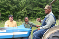 Lee Pauley (right) discusses his farming operation with NRCS employees Burthel Thomas and Abe Hester.