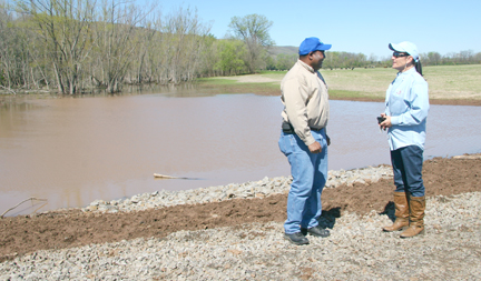 Ronnach Day, Conway County district conservationist, discuss the monitoring project planned on a Willow Bend Farm wetland with Ruth Spiller, farm manager.