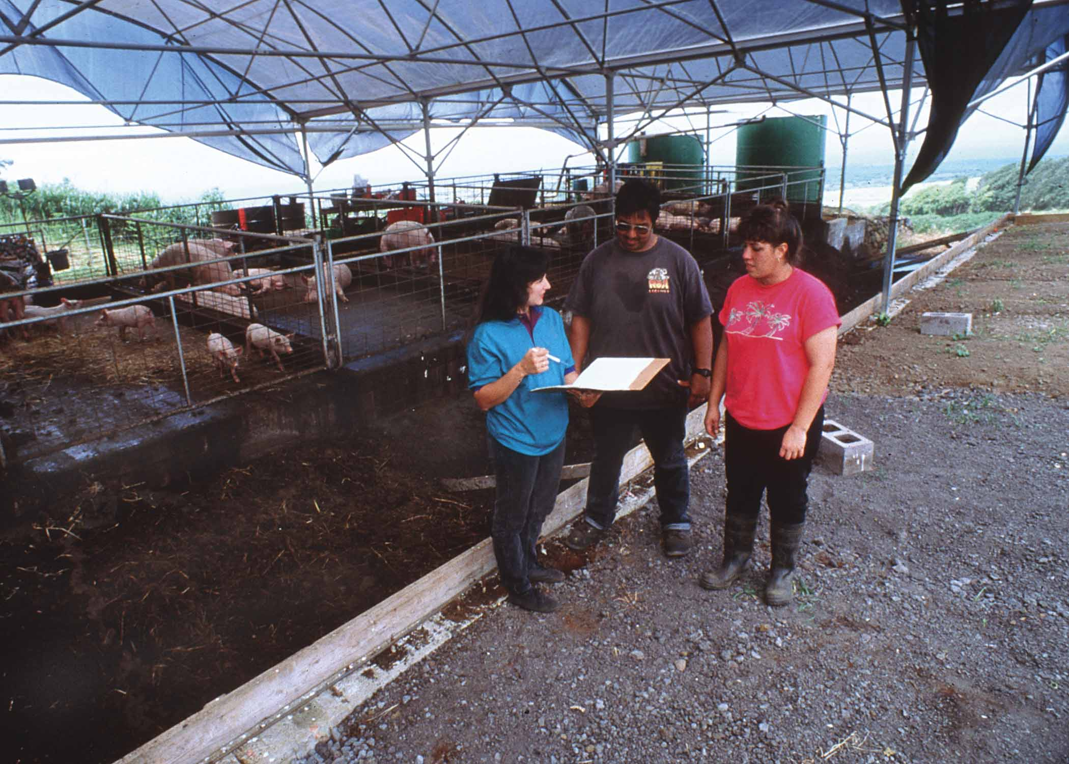 NRCS employee going over animal waste management with farm owner.