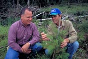 Dan Mast (left) and NRCS district conservationist Tom Purvis discuss ways to improve forest health on his land.