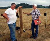 Rancher Sherril Wells (left) discusses his grazing management strategies with NRCS District Conservationist David Chain