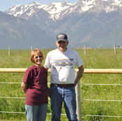 Joyce and Dan Gover standing side by side on their ranch in eastern Oregon.