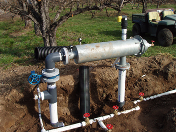 EQIP dollars at work installing a filter and micro sprinkler irrigation system on pear orchard.