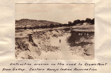 Caption: Distructive (sic) erosion on the road to Crown Point from Gallup. Eastern Navajo Indian Reservation.