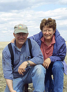 Carl and Janice Mattson, no-till wheat field in the background.