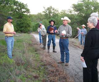 With Austin Shero (left), NRCS Soil Conservationist in Mineral Wells, Parker County TAES Agent Jon Green (center) talks with a group of attendees at Lake Mineral Wells State Park and Trailway during the Pasture Walk co-sponsored by NRCS, GLCI, TAES, and Texas Parks and Wildlife Department.