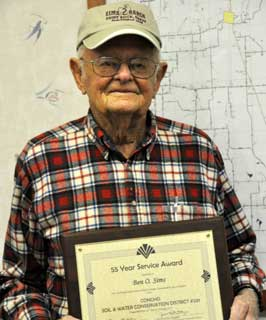 Ben Sims of Paint Rock, Texas holds his certificate honoring his 55 years of continued, dedicated service on the Concho Soil and Water Conservation Board.