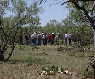 Participants of the Concho County Prescribed Burn Workshop tour and area recently burned within NRCS regulations and specifications.