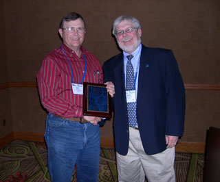 Mark Moseley, left, NRCS rangeland management specialist, is presented the NRCS Rangeland Management Specialist of the Year award by Dennis Thompson, right, NRCS national rangeland management specialist.