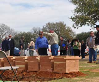 Three generations of Caddo Nation tribal members attended a recent ancestral burial ceremony at Nacogdoches Sunset Cemetery in Nacogdoches, Texas. Lyman Kionute (foreground, left) Caddo ceremonial leader and George Campbell (foreground, right) retired land and special projects agent for Nacogdoches County, visit at the gravesite prior to the re-internment. Out of respect to the Caddo Tribe, no pictures were taken during the sacred burial ceremony.