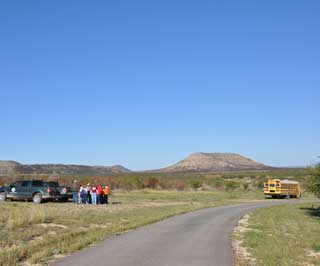 The backdrop for this year's Coke County Soil and Water Conservation District Conservation Day was the Wildcat Mountain Ranch, which was scorched during the Wildcat wildfire which engulfed nearly 160,000 acres.