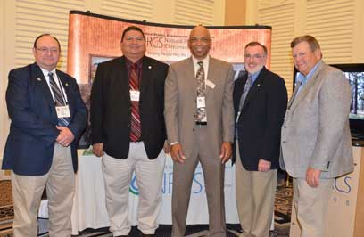 Standing from left to right are Texas NRCS State Conservationist Salvador Salinas; Kyle Williams, Tribal Council Vice Chairman of the Alabama-Coushatta Tribe of Texas; Ronald Harris, Texas NRCS District Conservationist in Livingston; Bruce Wight, NRCS National Forester, Washington, D.C.; and Garry Stephens, Texas NRCS Tribal Liaison and wildlife biologist based in Corpus Christi.