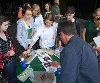 Dennis Brezina presents a training workshop focused on soils to students from College Park Academy of Science and Technology of The Woodlands.