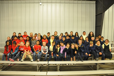 Nearly 50 3rd grade students from St. Ann's Catholic School in Midland and Garden City Elementary pose for a group shot during the annual Farm Tour Field Day.