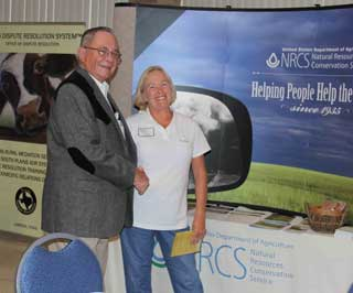 Mickey Black, NRCS assistant state conservationist and Peggy Cole, program manager for HMI, met during a break at the Lubbock workshop and discussed the benefits of the NRCS handouts and information provided to participants during the seminar.
