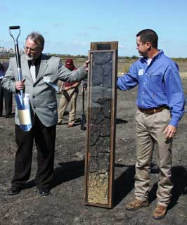 Commemorative Monolith and Shovel presented by Dennis Williamson (l) at the Last Acre Ceremony. Assisting is Richard Reid (r)